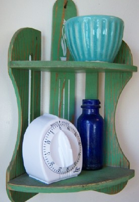 Green kitchen shelf w/blue Utah bottle